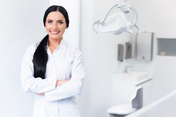 depositphotos_87334210-stock-photo-dentist-portrait-woman-smiling-at